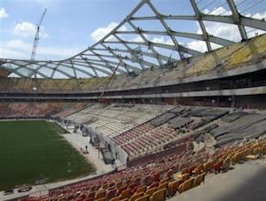 Steelworkers work on the roof structure inside the Arena Amazonia stadium as constrcution continues in preparation for the 2014 FIFA World Cup soccer championship in Manaus