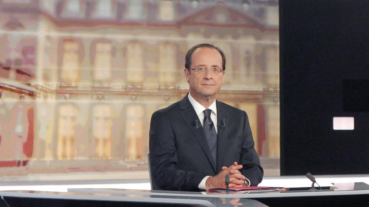 Socialist Party candidate for the presidential election Francois Hollande, poses before a televised debate with current President and conservative candidate for re-election Nicolas Sarkozy, unseen, in Paris, Wednesday, May, 2, 2012. (AP Photo/Patrick Kovarik, Pool)