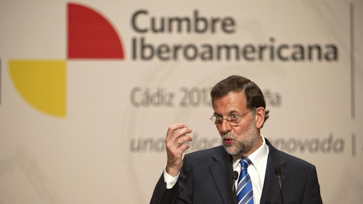 Spain's Prime Minister Mariano Rajoy, gestures during a press conference at the XXII Iberoamerican summit in the southern Spanish city of Cadiz, Saturday, Nov. 17, 2012. In an historic role reversal, recession-hit Spain and Portugal on Friday courted the Latin American leaders of their former colonies, countries that now enjoy some of the strongest economic growth in the world. Spain's King Juan Carlos opened the annual Iberoamerican summit, which brings together the heads of Spain and Portugal and the leaders of Latin America to discuss political issues and arrange business deals. (AP Photo/Miguel Angel Morenatti)