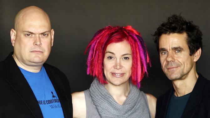 """This Oct. 14, 2012 photo shows directors-screenwriters Andy Wachowski, left, Lana Wachowski, center, and Tom Tykwer, from the upcoming film """"Cloud Atlas"""", in Beverly Hills, Calif. The film is an epic of shifting genres and intersecting souls that features Tom Hanks, Halle Berry, Jim Broadbent, Hugh Grant, Hugo Weaving, Ben Whishaw, Jim Sturgess, James D'Arcy, Doona Bae, Keith David, Sarandon and others in multiple roles spanning the centuries. (Photo by Matt Sayles/Invision/AP)"""