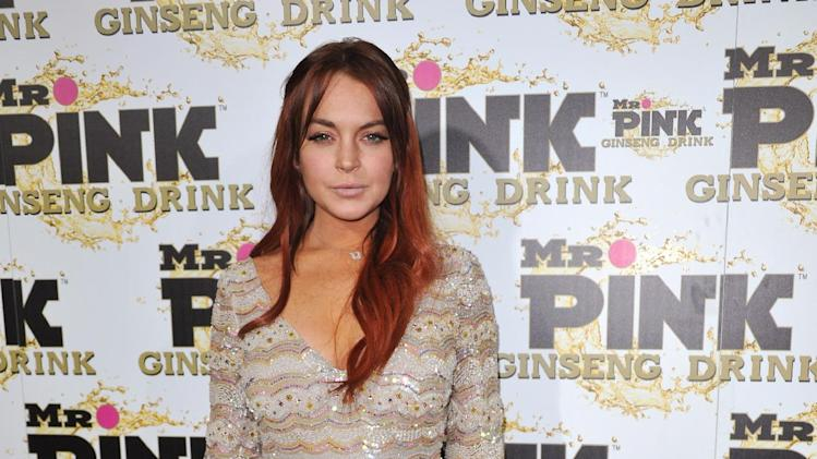 FILE - In this Oct. 11, 2012 file photo, Lindsay Lohan attends the Mr. Pink Ginseng launch party at the Beverly Wilshire hotel in Beverly Hills, Calif. Los Angeles city prosecutors said Tuesday Dec. 11, 2012 that they will seek to revoke Lohan's probation because the actress has been charged with three misdemeanors stemming from a June car crash. (Photo by Richard Shotwell/Invision/AP, File)