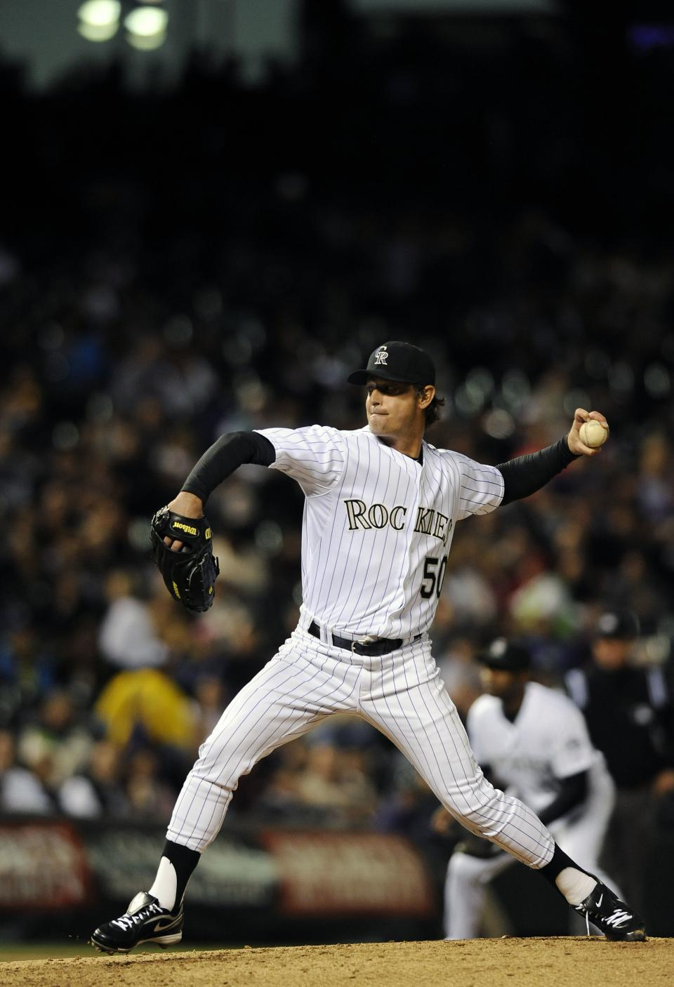 Colorado Rockies starting pitcher Jamie Moyer throws in the sixth inning of a baseball game against the San Diego Padres on Tuesday, April 17, 2012 in Denver. The Rockies won 5-3. Jamie Moyer became the oldest pitcher to win a major league game.(AP Photo/Chris Schneider)