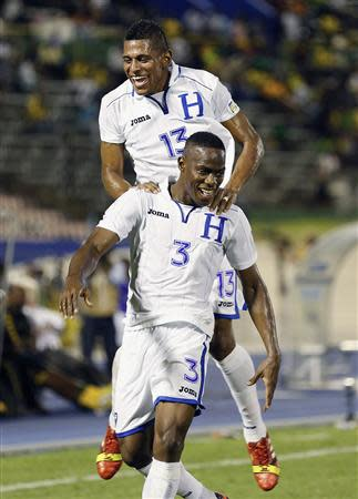 Honduras' Figueroa celebrates with teammate Costly after scoring the team's second goal against Jamaica in their 2014 World Cup qualifying soccer match in Kingston