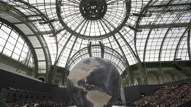 Models wear creations by German fashion designer Karl Lagerfeld for Chanel's Fall/Winter 2013-2014 ready to wear collection, in Paris, Tuesday, March, 5, 2013. (AP Photo/Christophe Ena)