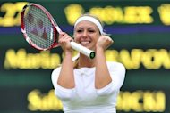 Germany's Sabine Lisicki celebrates her fourth round women's singles victory over Russia's Maria Sharapova on day seven of the 2012 Wimbledon Championships tennis tournament at the All England Tennis Club in Wimbledon, southwest London