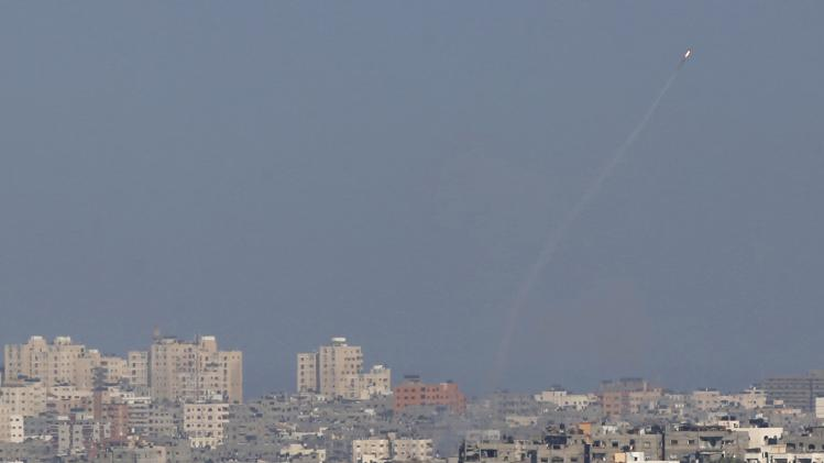 A smoke trail is seen as a rocket is launched from the Gaza Strip towards Israel