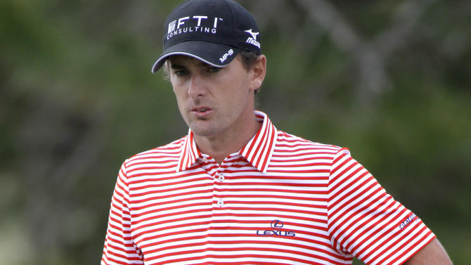 Charles Howell III waits for his turn to putt  on the eighth green during the third round of the Children's Miracle Network Hospitals golf tournament in Lake Buena Vista, Fla., on Saturday, Nov. 10, 2012. (AP Photo/Reinhold Matay)