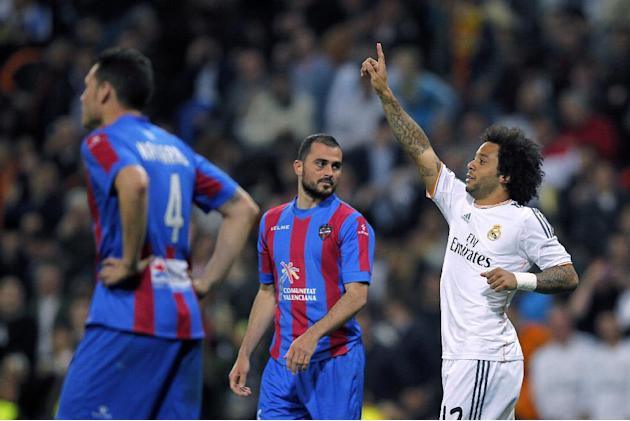 Real's Marcelo, right, celebrates his goal during a Spanish La Liga soccer match between Real Madrid and Levante at the Santiago Bernabeu stadium in Madrid, Spain, Sunday March 9, 2014