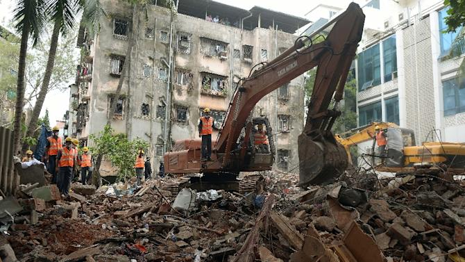 Rescuers pulled seven people out of the rubble alive after the three-storey structure crumbled overnight while families were sleeping inside