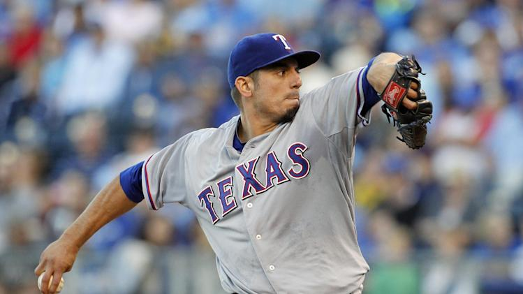 Garza, Rangers keep close in wild card, top Royals