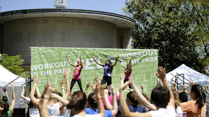 IMAGE DISTRIBUTED FOR SELF MAGAZINE -  Sarina Jain, center, leads attendees in the Masala Bhangra workout during SELF Magazine's Workout on the Quad event at American University, Saturday, April 27, 2013, in Washington.  This special on campus event was held in celebration of the 20th annual Workout in the Park outdoor fitness festival from SELF Magazine. (Nick Wass/AP Images for SELF Magazine)