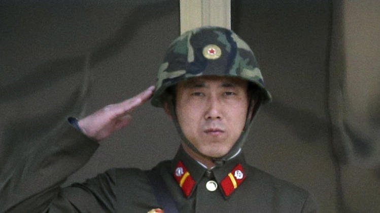 A North Korean soldier salutes to his senior soldiers, unseen, at the border village of Panmunjom, the demilitarized zone that has separated the two Koreas since the Korean War, in Paju, north of Seoul, South Korea, Tuesday, March 19, 2013. The United States is flying nuclear-capable B-52 bombers on training missions over South Korea to highlight Washington's commitment to defend an ally amid rising tensions with North Korea, Pentagon officials said Monday.  (AP Photo/Lee Jin-man)