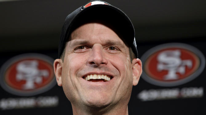 San Francisco 49ers head coach Jim Harbaugh smiles during a news conference at the 49ers NFL football headquarters in Santa Clara, Calif., Monday, Jan. 23, 2012. The 49ers lost to the New York Giants in the NFC championship game Sunday. (AP Photo/Paul Sakuma)