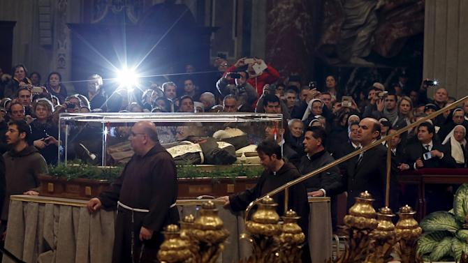 The crystal coffin containing the exhumed body of the mystic saint Padre Pio is seen at the end of the Ash Wednesday mass, in St. Peter's Basilica
