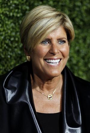 FILE - In this Jan. 6, 2011 file photo, Suze Orman arrives at the Oprah Winfrey Network Television Critics Association 2011 Winter Press Tour Cocktail Reception in Pasadena, Calif. Orman is aiming to be first out of the gate in the fast-growing prepaid debit card market with a card that may help its users build a credit score. (AP Photo/Matt Sayles, files)