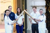 Prince William and Catherine next to Prince Harry during a torch relay at the Buckingham Palace in London, on July 26, 2012