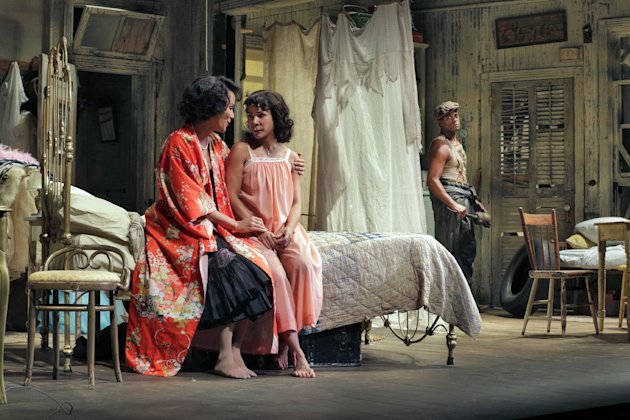 "In this April 2, 2012 photo provided by Springer Associates, from left, actors Nicole Ari Parker and Daphne Rubin-Vega, portraying Blanche and Stella, talk about character Stanley, played by Blair Underwood, in a scene from ""A Streetcar Named Desire"" at the Broadhurst Theatre in New York. A talented multi-racial cast tackles Tennessee Williams' Pulitzer Prize-winning play about the clash between an aging and delusional Southern belle and her brutish brother-in-law. It opens Sunday, April 22, 2012. (AP Photo/Springer Associates, Ken Howard)"