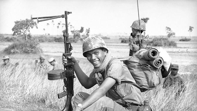 """FILE-This Sept. 20, 1970, file photo taken by Associated Press photographer, Huynh Cong """"Nick"""" Ut, shows a Cambodian soldier on an operation in Vietnam. It only took a second for Ut to snap the iconic black-and-white image of Phan Thi Kim Phuc after a napalm attack in 1972, but it communicated the horrors of the Vietnam War in a way words could never describe, helping to end one of America's darkest eras. (AP Photo/Nick Ut)"""