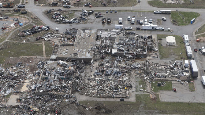 Wreckage of the Plaza Towers Elementary School in Moore, Okla., is pictured from a National Guard helicopter during a tour of tornado damaged areas by Oklahoma Gov. Mary Fallin, Tuesday, May 21, 2013. (AP Photo/Sue Ogrocki, Pool)