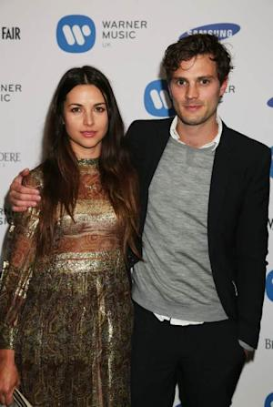 Amelia Warner and Jamie Dornan attend the Warner Music Group Post BRIT Party In Association With Samsung at The Savoy Hotel on February 20, 2013 in London -- Getty Images
