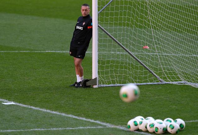 Portugal's coach Paulo Bento watches the players warm up during a training session Sunday, Nov. 17 2013, at the Luz stadium in Lisbon. Portugal will play Sweden Tuesday in a World Cup qualifying playo