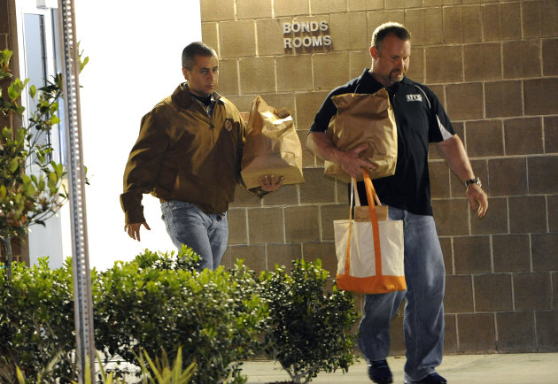 George Zimmerman, left, walks out of the intake building at the John E. Polk Correctional Facility with an unidentified man on Sunday, April 22, 2012, in Sanford, Fla.  Zimmerman posted bail on a $150