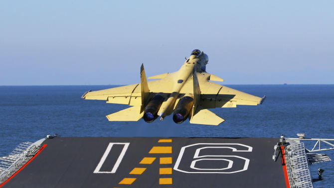 In this undated photo released by China's Xinhua News Agency, made available on Sunday, Nov. 25, 2012, a carrier-borne J-15 fighter jet takes off from China's first aircraft carrier, the Liaoning. China has successfully landed a fighter jet on its first aircraft carrier, which entered service two months ago, the country's official news agency confirmed Sunday. The Liaoning aircraft carrier underscores China's ambitions to be a leading Asian naval power, but it is not expected to carry a full complement of planes or be ready for combat for some time.  (AP Photo/Xinhua, Zha Chunming) NO SALES