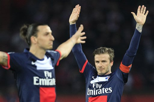 Paris Saint Germain's midfielder David Beckham from England, right, celebrates after Paris Saint Germain's forward Zlatan Ibrahimovic from Sweden, left, scores during their French League One soccer ma