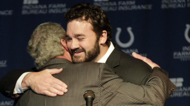 Jeff Saturday, right, gets a hug from Colts owner Jim Irsay  at a news conference before signing a one day contract in order to retire as an Indianapolis Colt Thursday, March 7, 2013, in Indianapolis. Saturday spent 13 seasons in Indianapolis before signing with Green Bay last year. (AP Photo/AJ Mast)