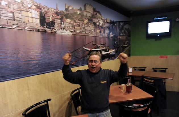 Portuguese Jorge Rodrigues, 58-year-old, celebrates Portugal's Cristiano Ronaldo 3rd goal during the World Cup qualifying playoff second leg soccer match between Sweden and Portugal in his wife coffee