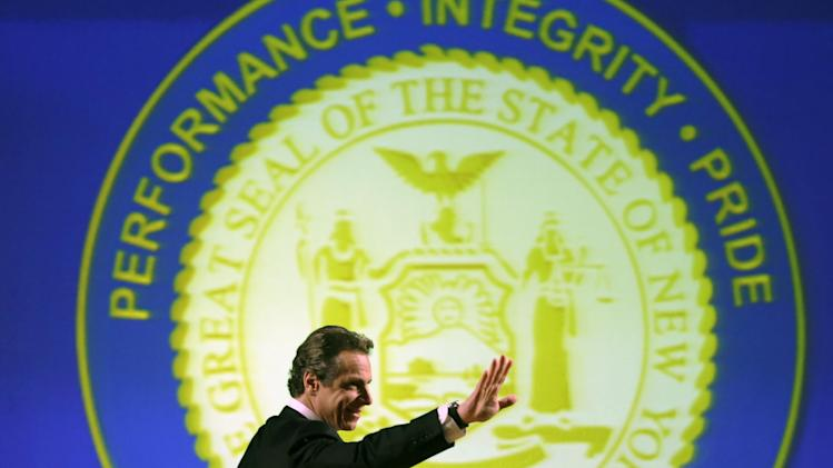 New York Gov. Andrew Cuomo arrives to deliver his third State of the State address at the Empire State Plaza Convention Center on Wednesday, Jan. 9, 2013, in Albany, N.Y. (AP Photo/Mike Groll)