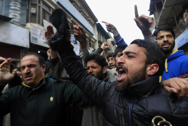 Supporters of Jammu Kashmir Liberation Front (JKLF) shout pro freedom slogans during a protest in Srinagar, India, Friday, March 7, 2014. Dozens of Muslim students from the disputed Indian territory o