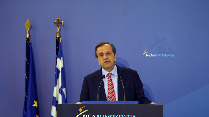 """Greek Prime Minister Antonis Samaras speaks to his parliamentary group of lawmakers about the upcoming vote on the new round of austerity measures next week, at the headquarters  of conservative """"New Democracy"""" party, in Athens, Sun. Nov. 4 2012. Greece's coalition government is struggling to push through a new round of austerity measures that is set to impose new wage, pension, and benefit cuts on a public already plagued by 25 percent unemployment. (AP Photo/Kostas Tsironis)"""