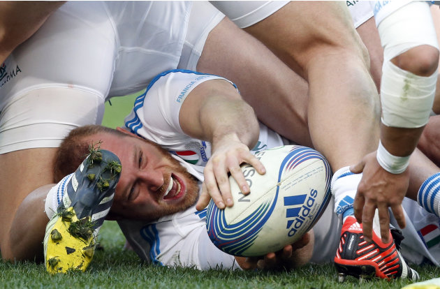 Italy's Leonardo Ghiraldini passes the ball during their Six Nations rugby match against France at the Olympic stadium in Rome