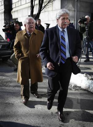 FILE - In this Jan. 18, 2013 file photo, Mark Strong Sr., right, and his attorney, Dan Lilley, leave the Cumberland County Court House in Portland, Maine. The trial of a key figure in a prostitution scandal at a Zumba studio in Maine has gone through four days without a jury being selected. And it's unclear if the process will resume Monday. The defense is worried that the lengthy delays could cause potential jurors to turn against Strong even before jury selection is completed and the trial begins in earnest. (AP Photo/Robert F. Bukaty, File)