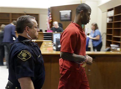 Boston Celtics NBA basketball player Terrence Williams, right, is led from a courtroom Monday, May 20, 2013, in Kent, Wash. Williams was arrested Sunday and accused of brandishing a gun at the mother of his 10-year-old son during a visitation exchange