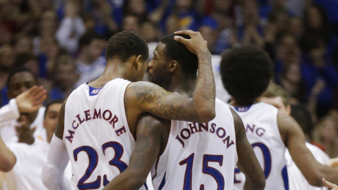 Kansas guards Ben McLemore (23) and Elijah Johnson (15) walk to the bench during a timeout in the second half of an NCAA college basketball game against Oklahoma State in Lawrence, Kan., Saturday, Feb. 2, 2013. Oklahoma State won 85-80. (AP Photo/Orlin Wagner)