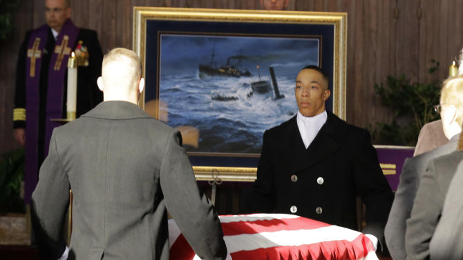 One of two caskets of remains is brought to the front of Fort Meyer Memorial Chapel during services to honor two sailors from the Civil War ship, the USS Monitor, Friday, March 8, 2013 in Arlington, Va. A century and a half after the Civil War ship the USS Monitor sank, two unknown crewmen found in the ironclad's turret were buried at Arlington National Cemetery. Friday's burial may be the last time Civil War soldiers are buried at the cemetery. (AP Photo/Alex Brandon)