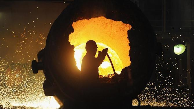 A worker operates a furnace at a steel plant in Hefei