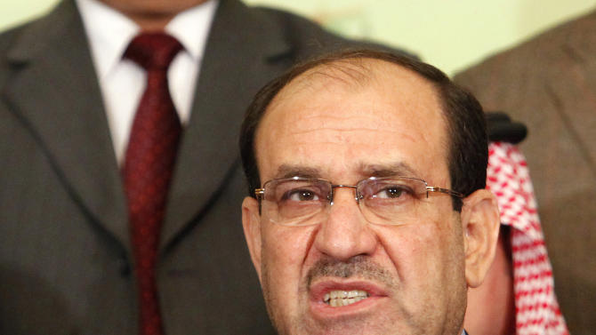 FILE - In this March 26, 2010 file photo, Iraqi Prime Minister Nouri al- Maliki speaks to the press in Baghdad, Iraq. Iraq's first major trial dealing with the country's savage Sunni-Shiite sectarian killings is tainted by politics, critics say _ an ominous sign for those hoping for justice for tens of thousands of victims of street executions, bombings and kidnappings. The defendant, Vice President Tariq al-Hashemi, says charges that he ran Sunni death squads are part of a political vendetta by Prime Minister Nouri al-Maliki, a Shiite. Al-Hashemi's nine-member legal team walked out in protest in the second court session late last month, citing judicial bias. And the prosecution's case relies heavily on the testimony of co-defendants, that the defense claimed was coerced, pointing to one who died in custody.(AP Photo/Hadi Mizban, File)