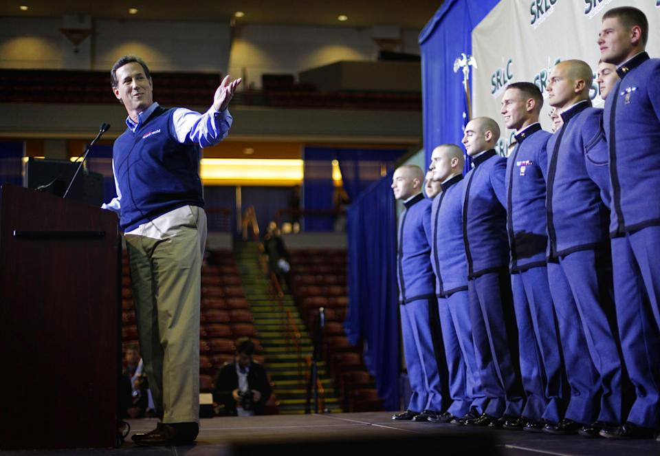 Republican presidential candidate, former Pennsylvania Sen. Rick Santorum, accompanied by students from the Citadel Military College of South Carolina, speaks to the Southern Republican Leadership Conference, Thursday, Jan. 19, 2012, in Charleston, S.C. (AP Photo/David Goldman)