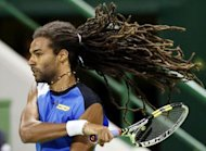 Germany&#39;s Dustin Brown returns the ball to Spain&#39;s David Ferrer during the 2013 ATP Qatar Open in Doha on January 1, 2013. Ferrer won 5-7, 6-3, 6-2
