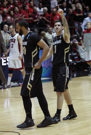 Colorado guard Nate Tomlinson (1) and Carlon Brown acknowledge the fans after defeating UNLV in an NCAA tournament second-round college basketball game  Thursday, March 15, 2012, in Albuquerque, N.M. Colorado won 68-64. (AP Photo/Jake Schoellkopf)