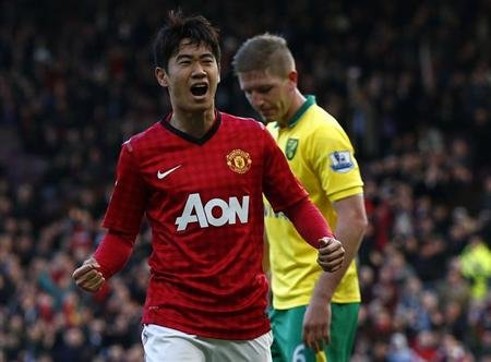 Manchester United's Kagawa celebrates his goal against Norwich City during their English Premier League soccer match in Manchester
