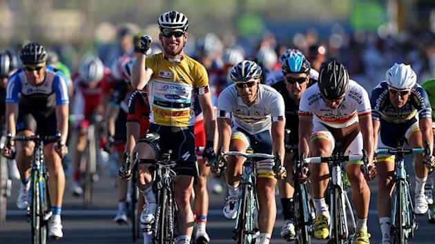 Omega Pharma-Quick Step team's leader Mark Cavendish (C-L) celebrates after winning the last stage of the 2013 Tour of Qatar, from Cyline beach to the Doha Cornich (AFP)