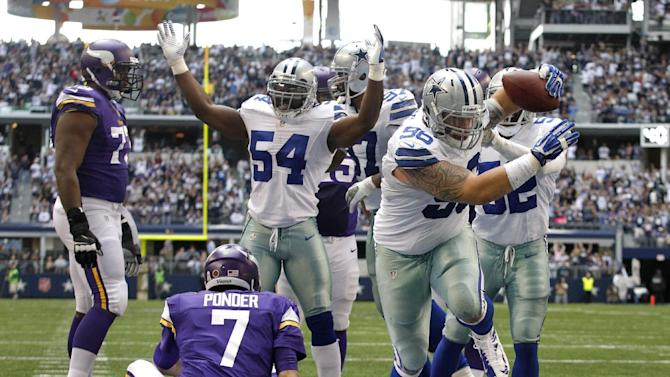 Dallas Cowboys' Bruce Carter (54) signals touchdown as Nick Hayden (96) comes up with a fumble by Minnesota Vikings' Christian Ponder (7) in the end zone for a touchdown in the second half of an NFL football game, Sunday, Nov. 3, 2013, in Arlington, Texas