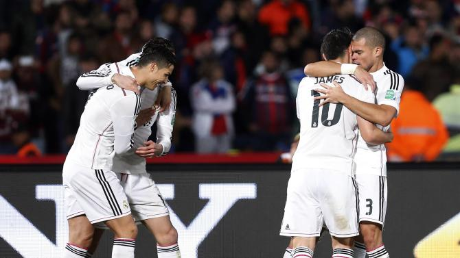 Real Madrid's Ronaldo celebrates with team mates after their team scored their second goal during their Club World Cup final soccer match against San Lorenzo at the Marrakech stadium