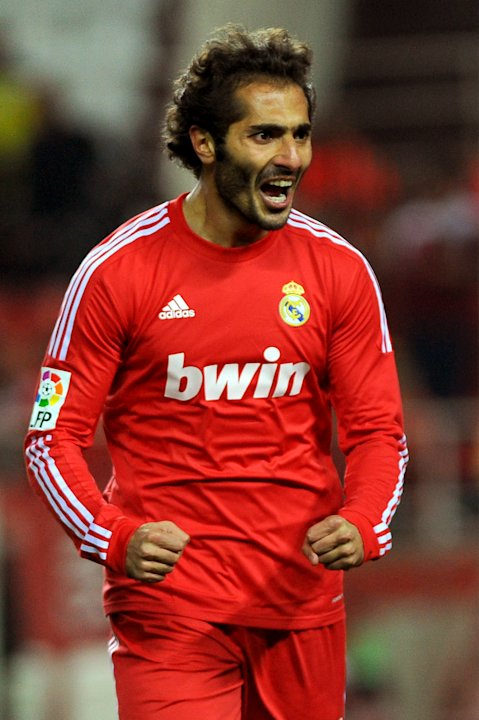 Real Madrid's midfielder Turkish Hamit Altintop celebrates after scoring during their Spanish league football match Sevilla FC vs Real Madrid on December 17, 2011 at Ramon Sanchez Pizjuan stadium in S