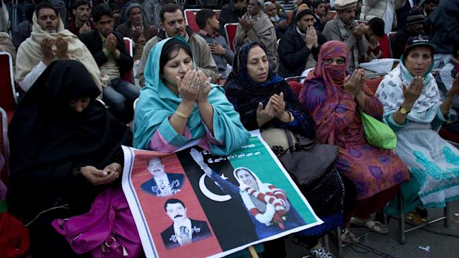 Supporters of Pakistan's assassinated leader Benazir Bhutto pray during her fifth death anniversary in Rawalpindi, Pakistan, Thursday, Dec. 27, 2012. The 24-year-old son of former Pakistani Prime Minister Benazir Bhutto has launched his political career at his ancestral place Larkana, with a fiery speech on the fifth anniversary of his mother's assassination. (AP Photo/B.K. Bangash)