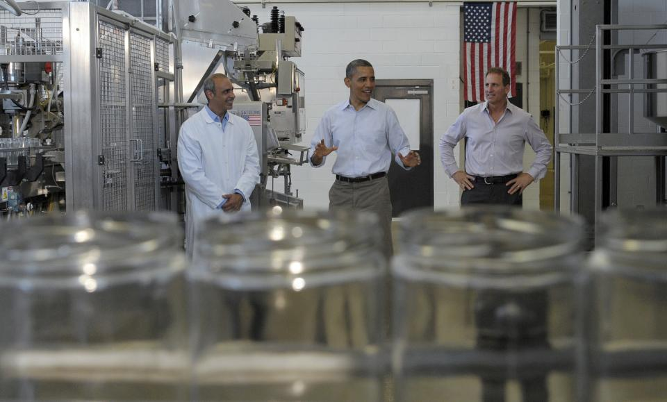 President Barack Obama stands with Summer Garden Food Manufacturing President and CEO  Tom Zidian, left, and employee Brian Zidian while touring the Summer Garden Food Manufacturing in Boardman, Ohio, Friday, July 6, 2012. Obama is on a two-day bus trip through Ohio and Pennsylvania. (AP Photo/Susan Walsh)